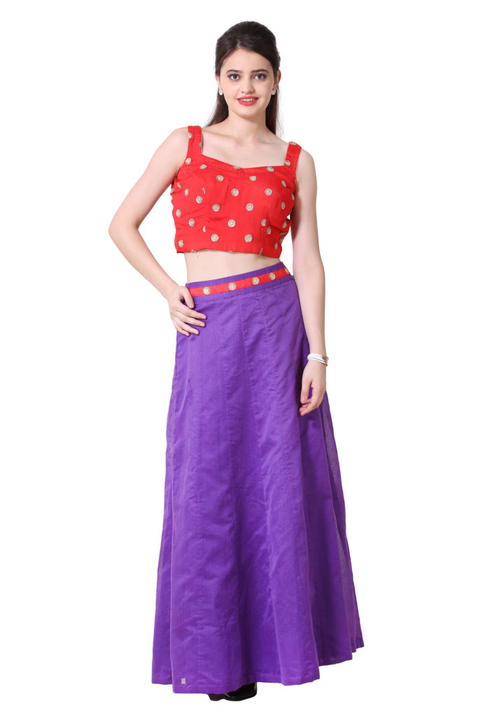 Bright red blouse with purple Kali skirt.