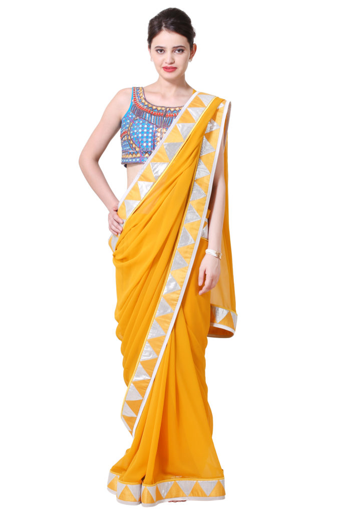 Yellow Saree with border and beautiful mirror work blouse.